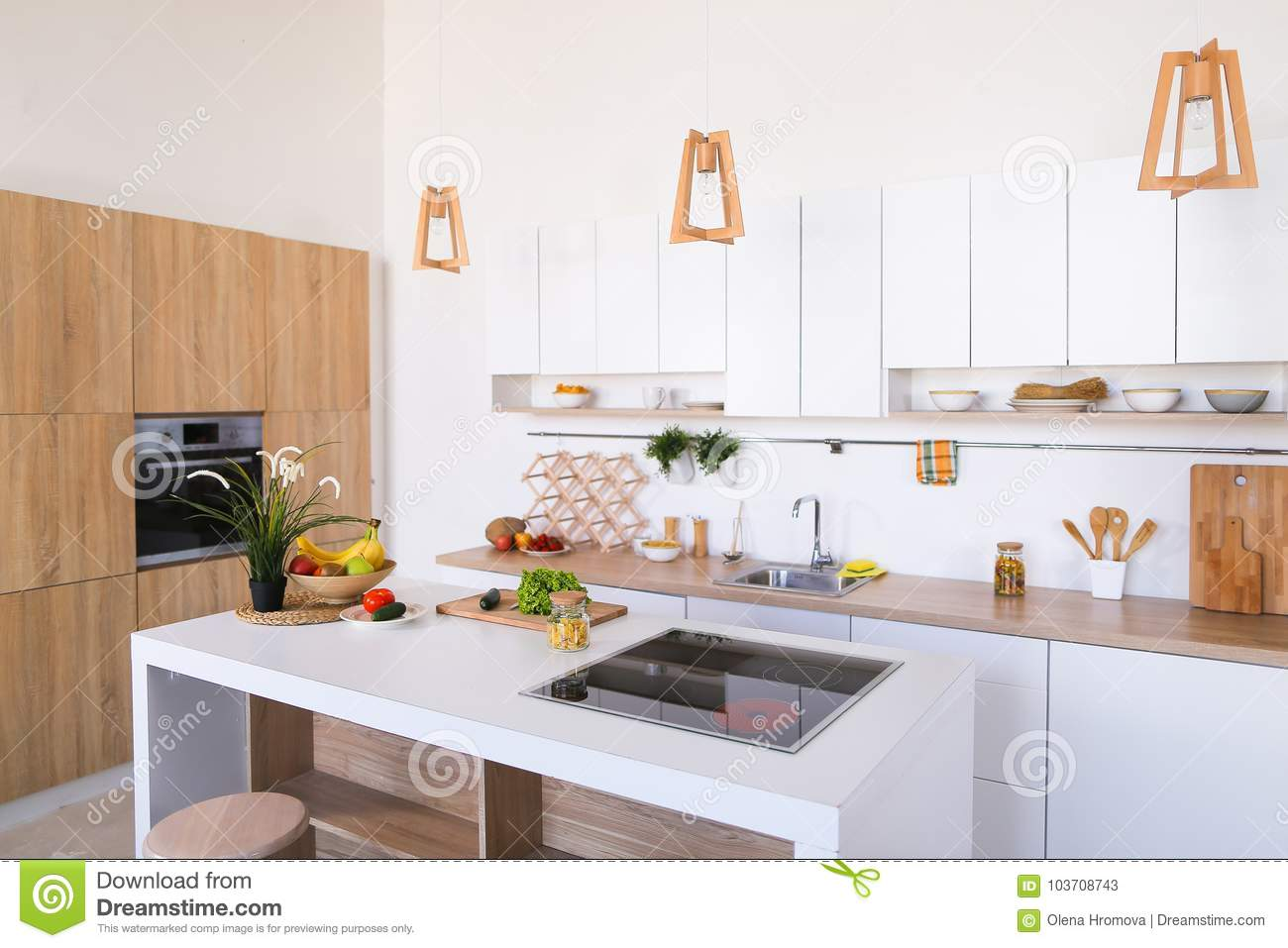 Interior Of Modern Light Kitchen With Variety Of Appliances And ...