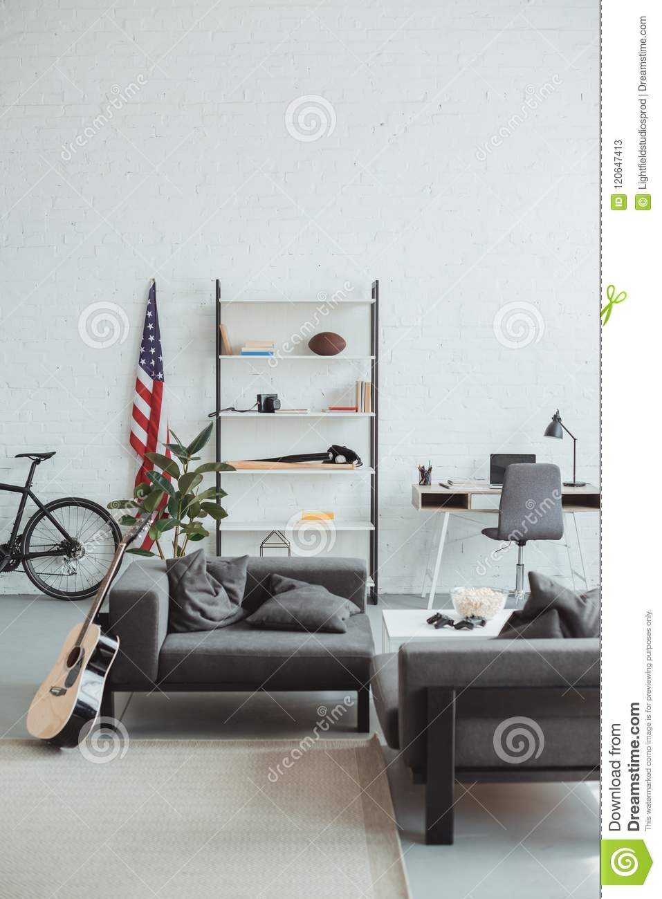 Download Interior Of Modern Living Room With Bicycle, Guitar, American Flag,  Laptop,