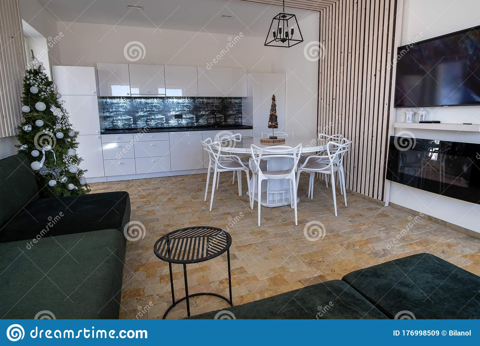 Interior Of Modern Spacious Kitchen With White Walls Decorative Wooden Elements Contemporary Furniture And Big Soft Couch Stock Image Image Of Furnished Large 176998509