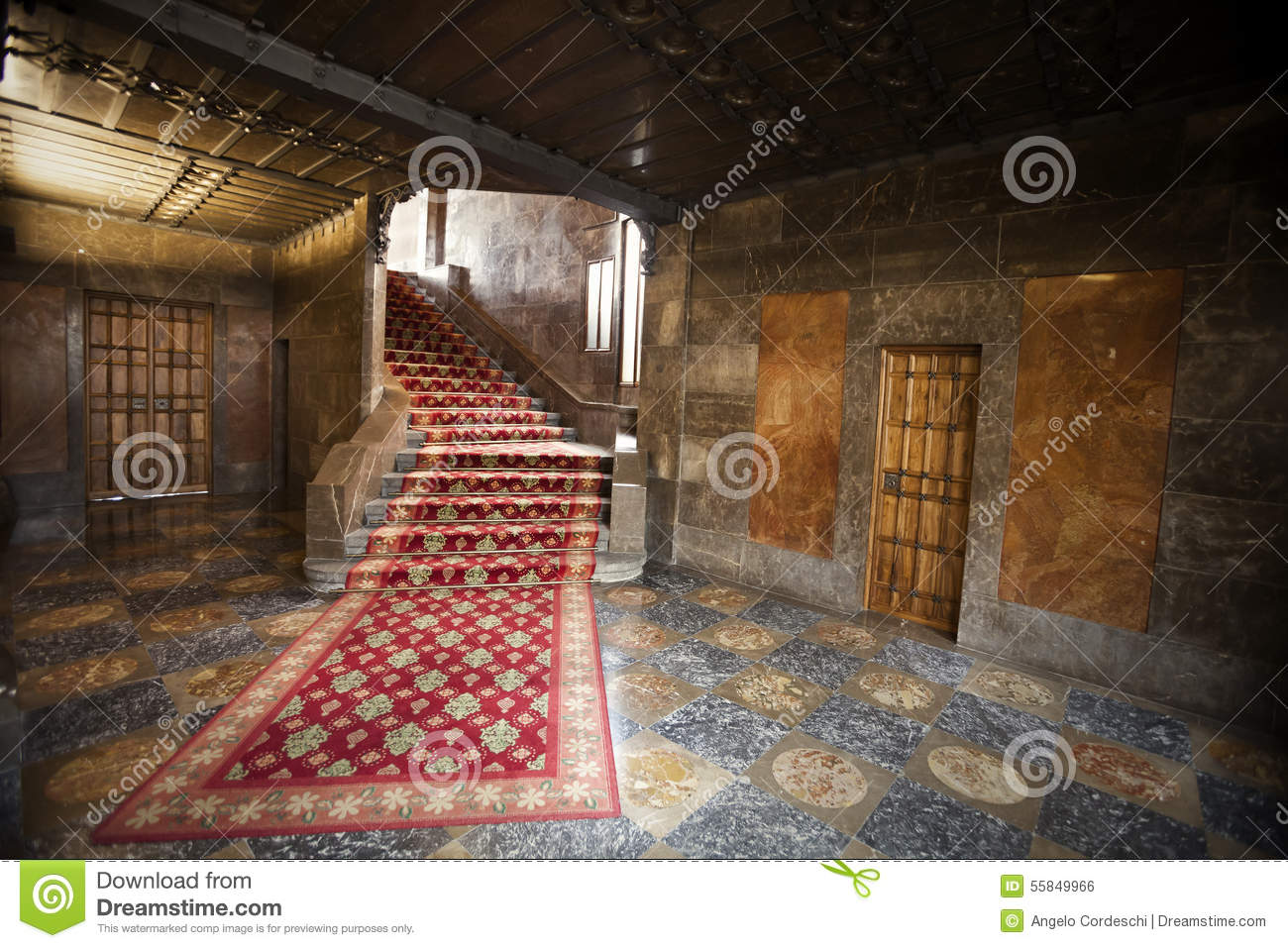 Interior Of An Old Spanish House With Red Carpet Stairs And Doors