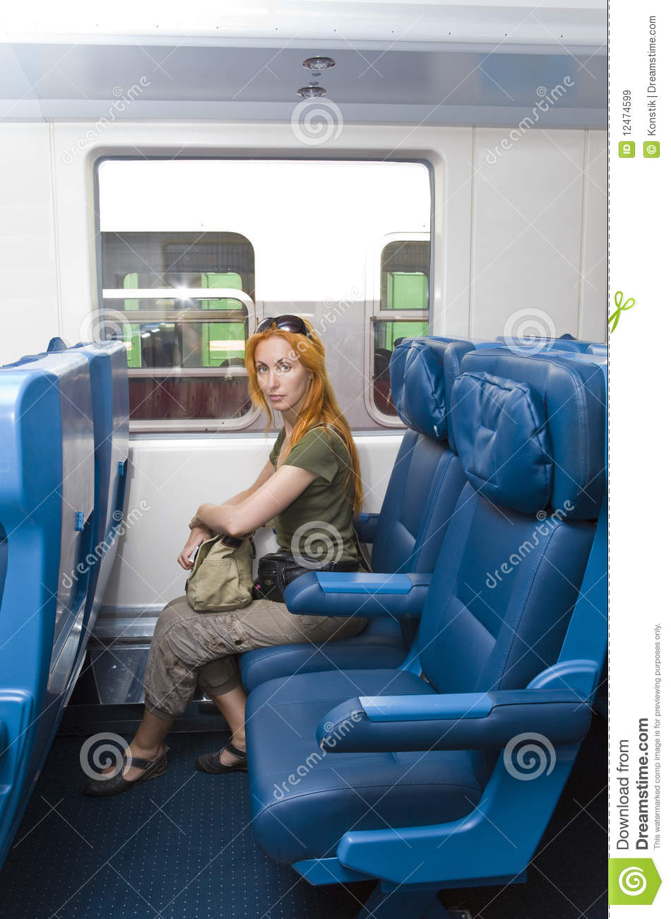interior of a passenger train with young woman royalty free stock images image 12474599. Black Bedroom Furniture Sets. Home Design Ideas
