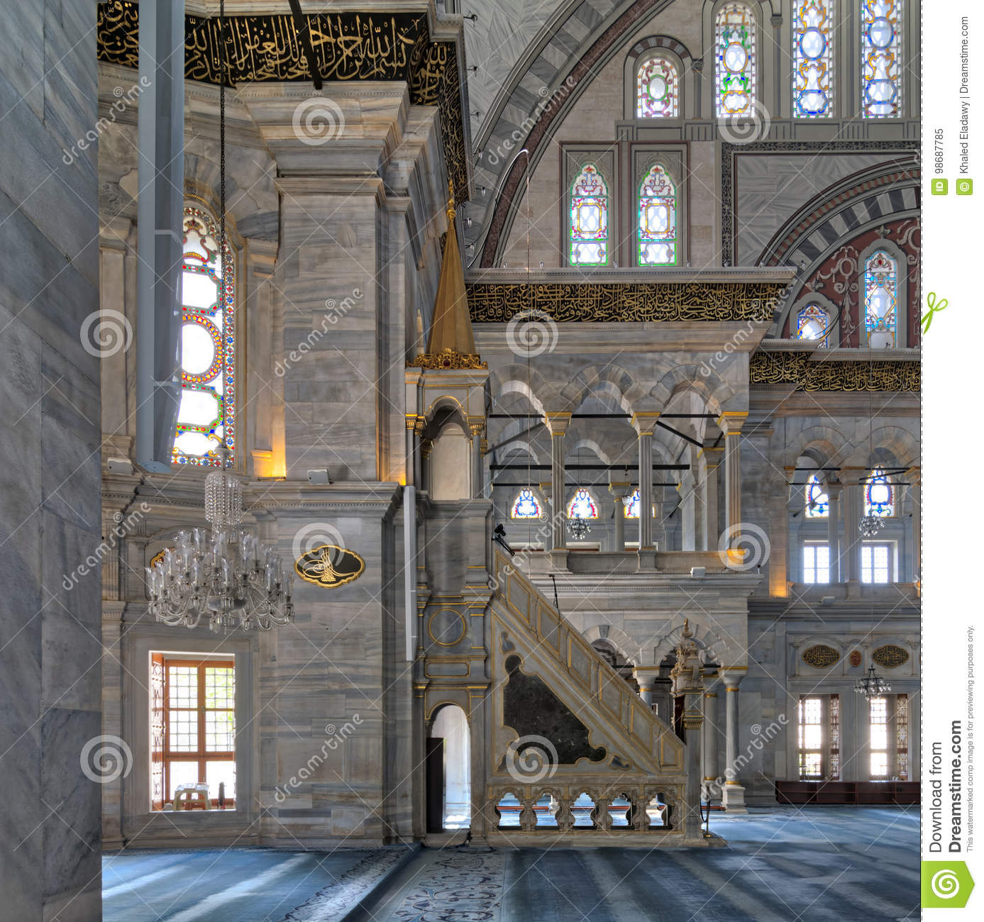 Interior shot of Nuruosmaniye Mosque with minbar platform, arches & colored stained glass windows, Istanbul, Turkey