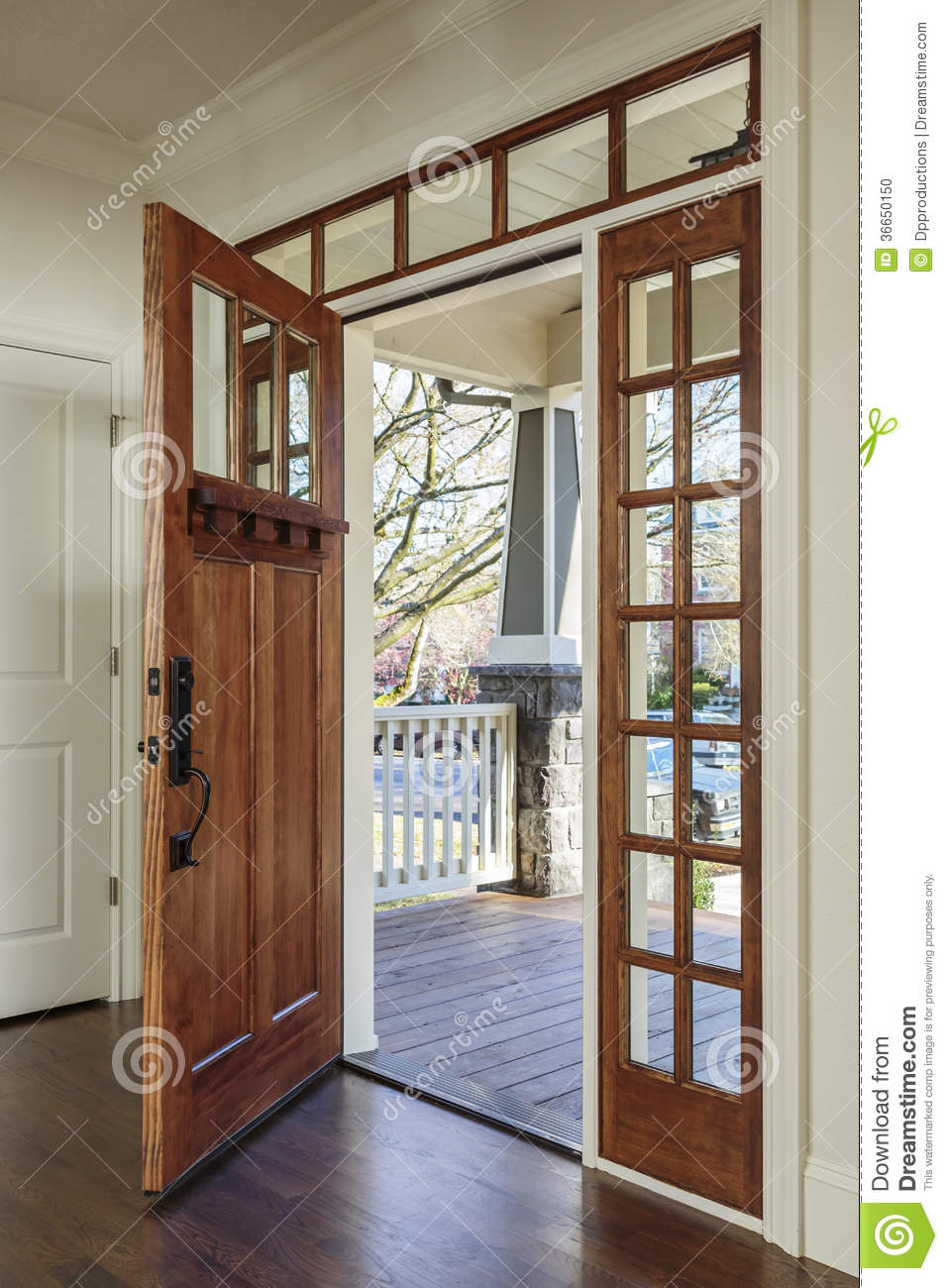 Interior shot of an open wooden front door stock photo for Entry door with window that opens