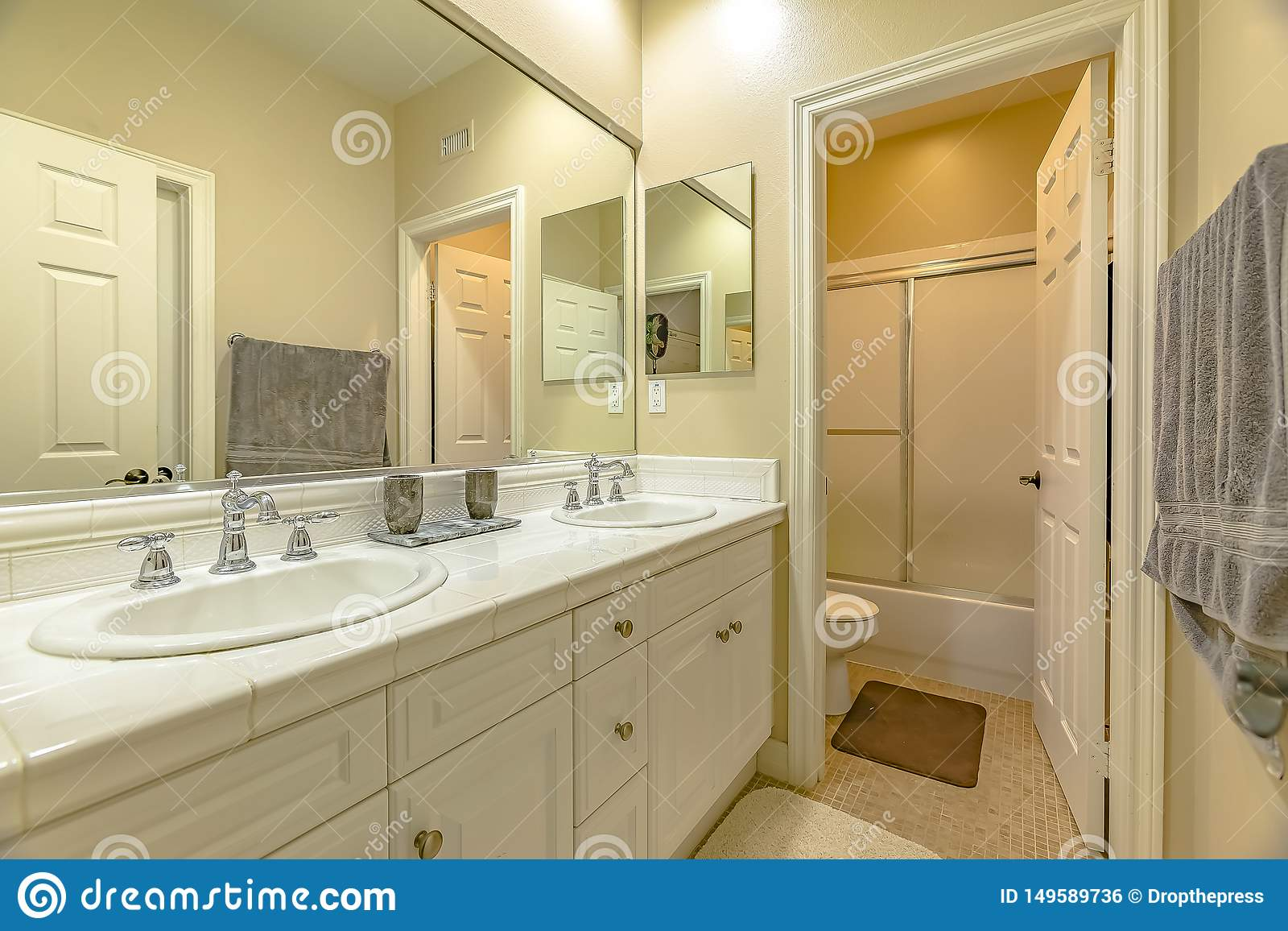 Interior Of A Small Bathroom With A Double Sink Vanity Area And Wood Cabinets Stock Photo Image Of Inside Home 149589736