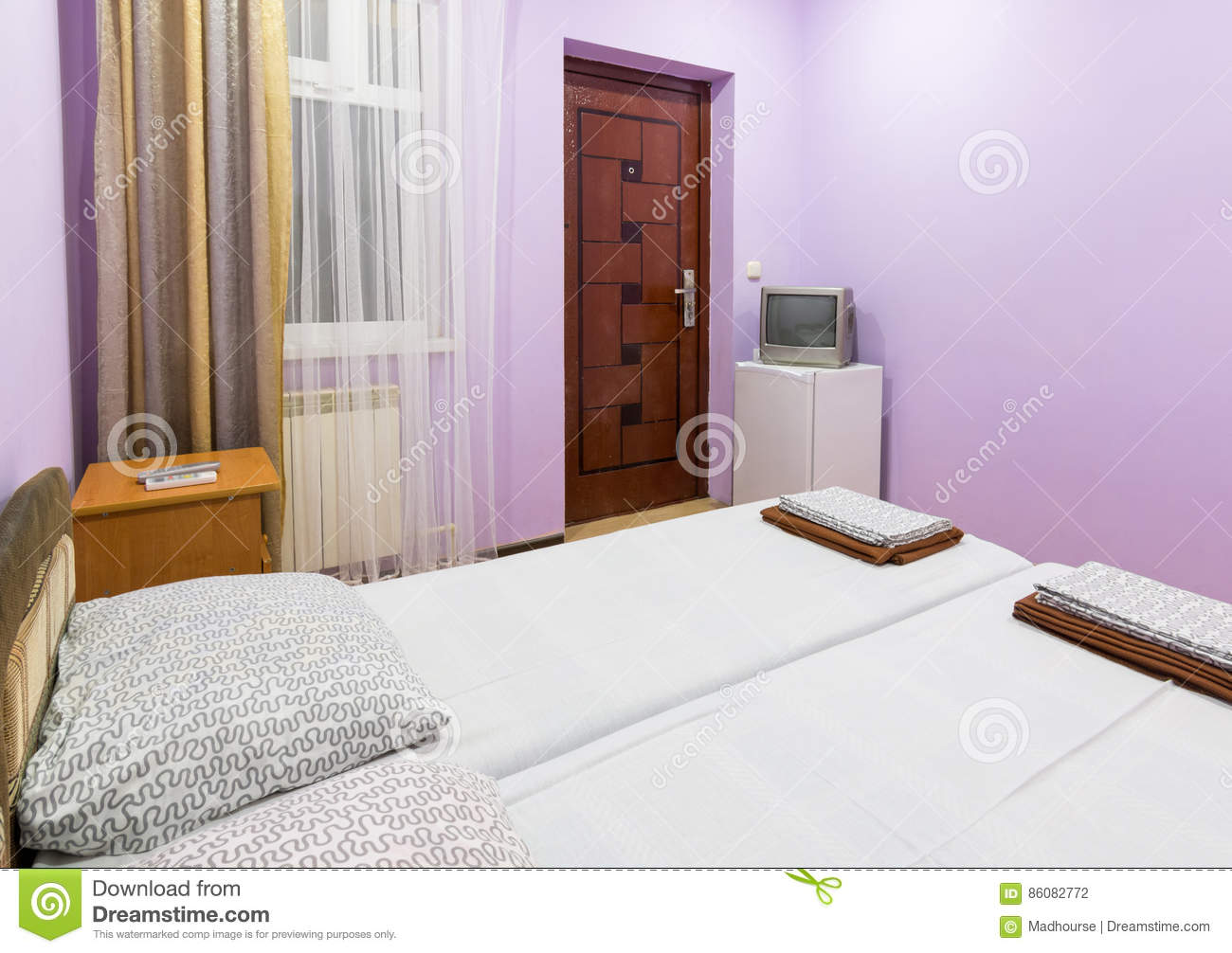 Interior Of A Small Room With A Double Bed, A Window, A TV And A ...