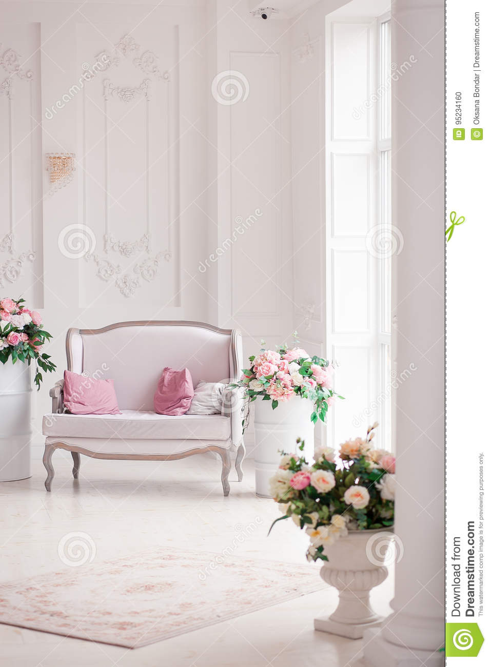 Download Interior Of A Snow White Living Room With A Vintage Sofa And  Flowers Stock