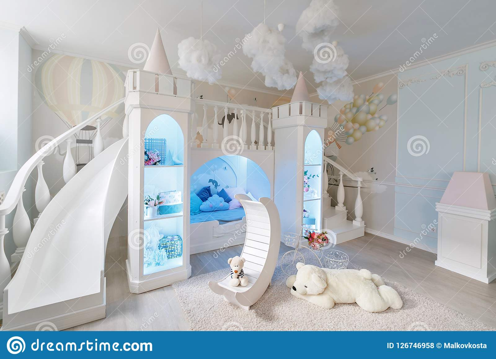 Interior Of A Spacious Children`s Room. Decorative Castle With Bed ...