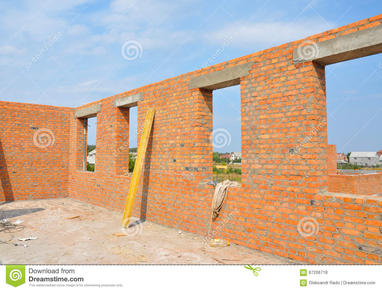 Interior of a unfinished red brick house under for Brick home construction