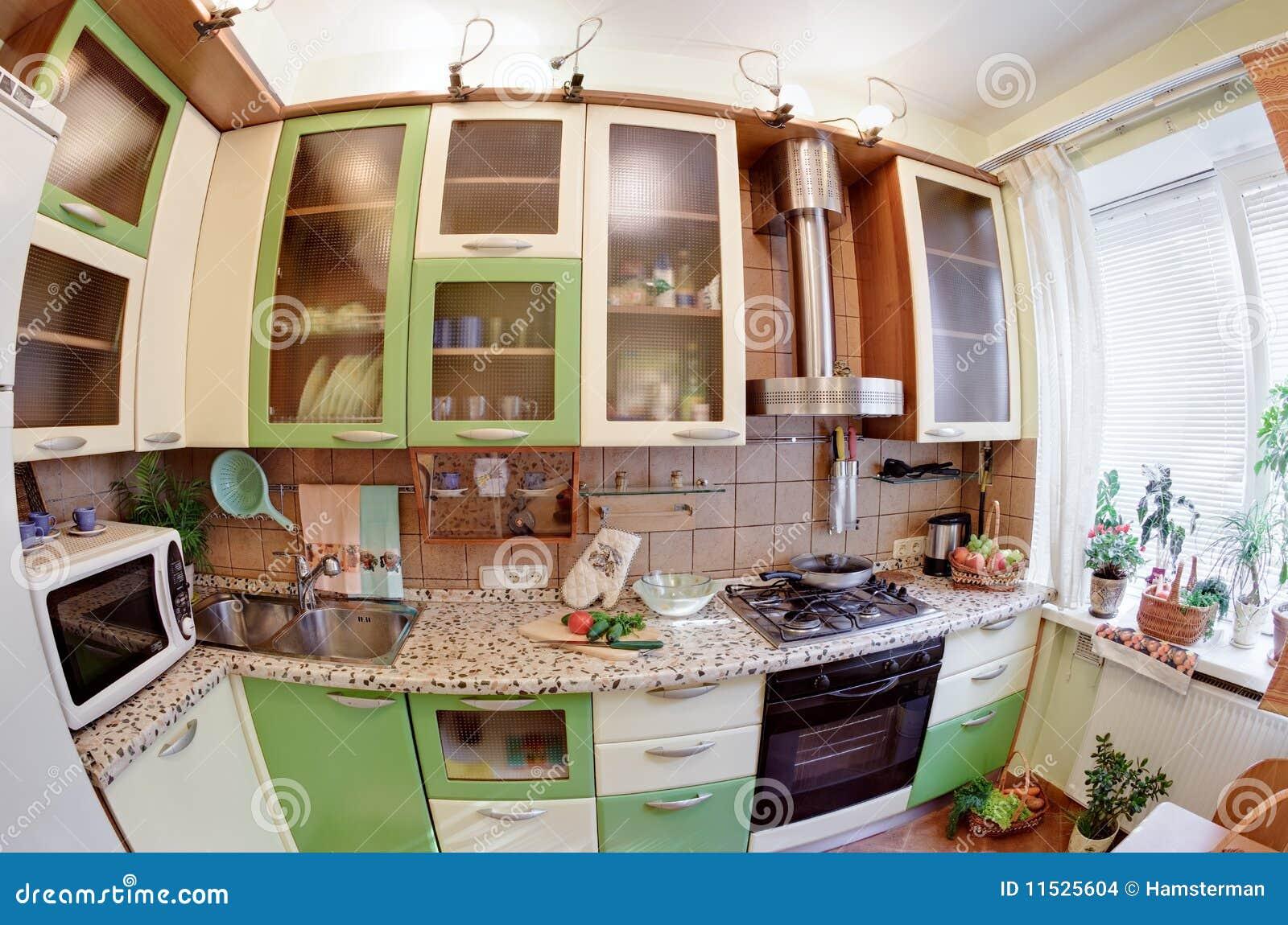 Interior verde da cozinha com muitos utensílios e indicador opinião  #714126 1300 951