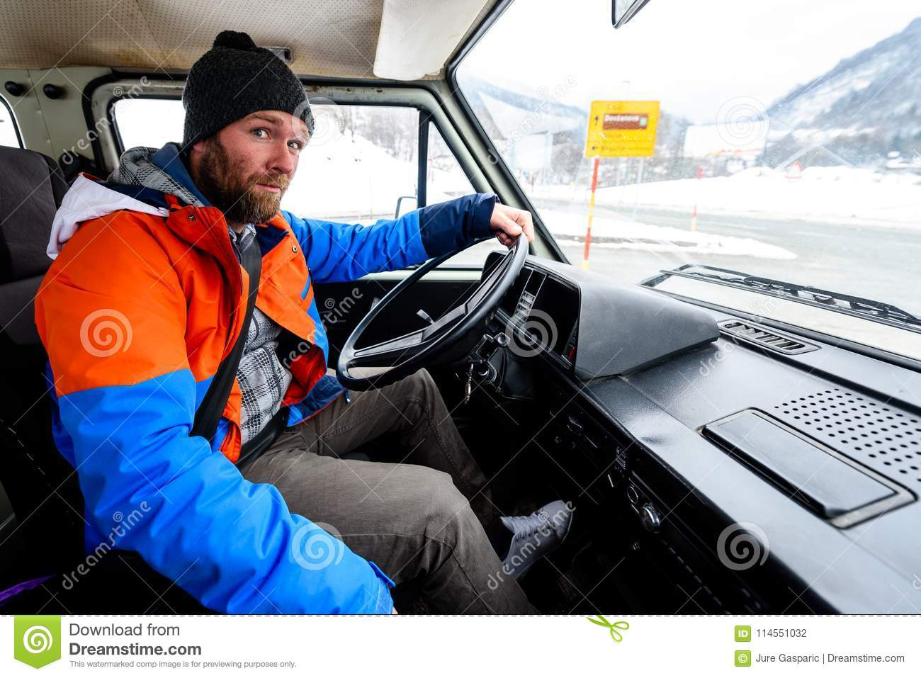 Interior View Of Delivery Man Driving A Van Or Truck  Stock Photo