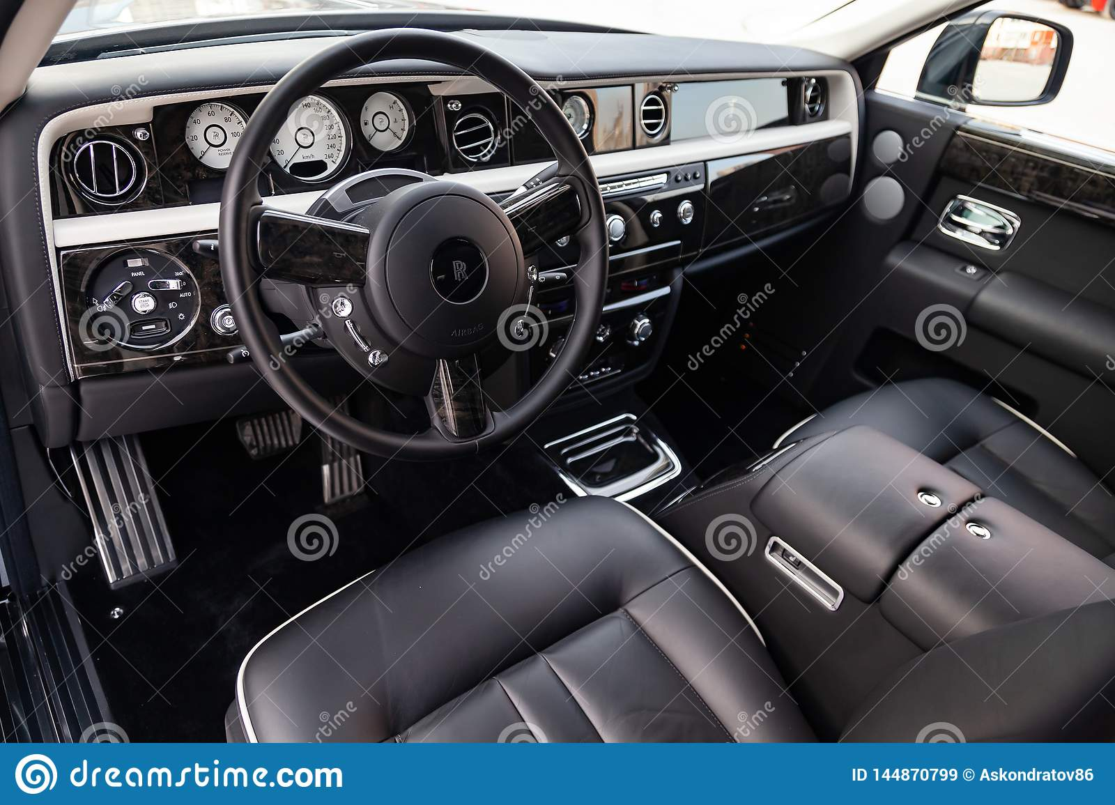 Interior View Of New A Very Expensive Rolls Royce Phantom Car A Long Black Limousine With Dashboard Steering Wheel Seats On Editorial Stock Image Image Of Rolls Dashboard 144870799