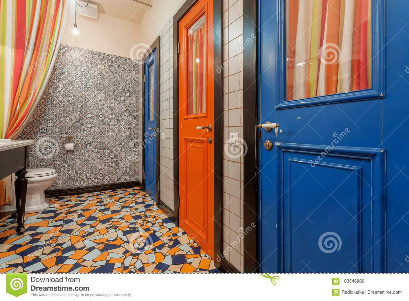 Interior Of Vintage Style Toilet Room With Old Wooden Doors To Bathroom.  Blue And Red
