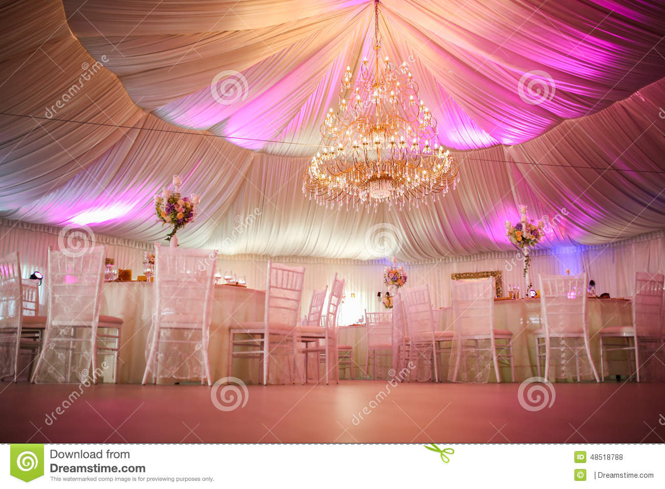 Interior of a wedding tent decoration ready for guests for Wedding interior decoration images