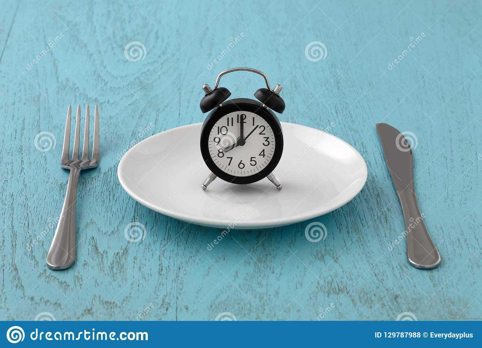 Intermittent Fasting With Clock On White Plate Stock Photo - Image