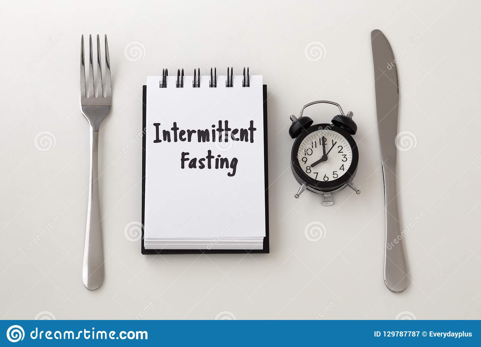 Intermittent Fasting Word On Notepad With Clock Stock Image