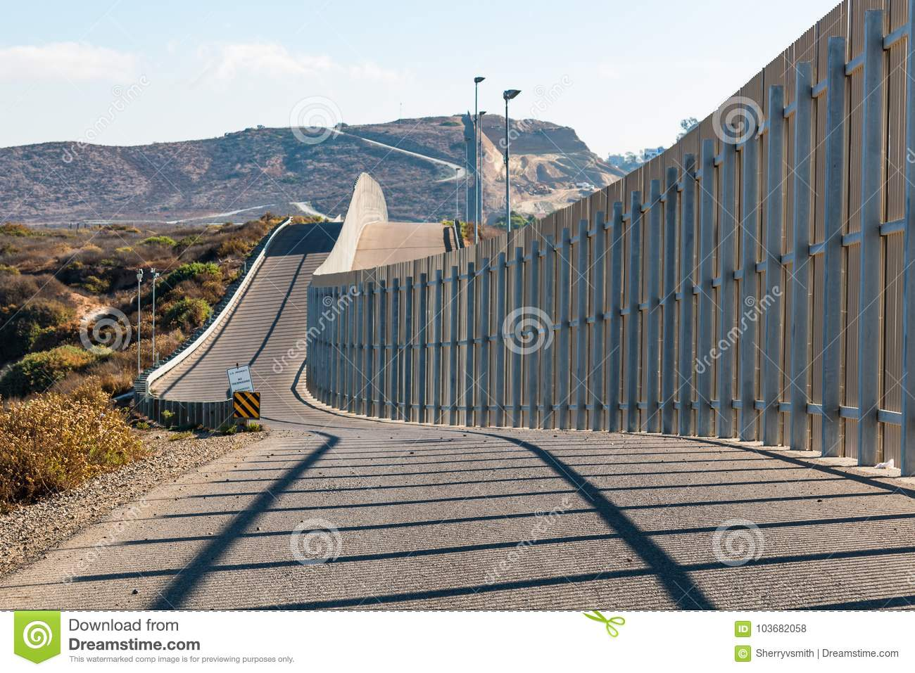 International Border Wall Between San Diego and Tijuana Extending into Distant Hills