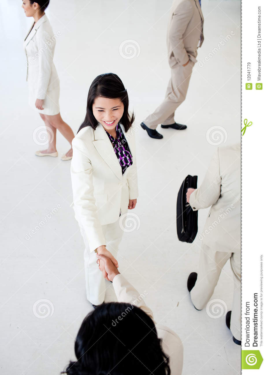 International Business People Greeting Each Other Stock