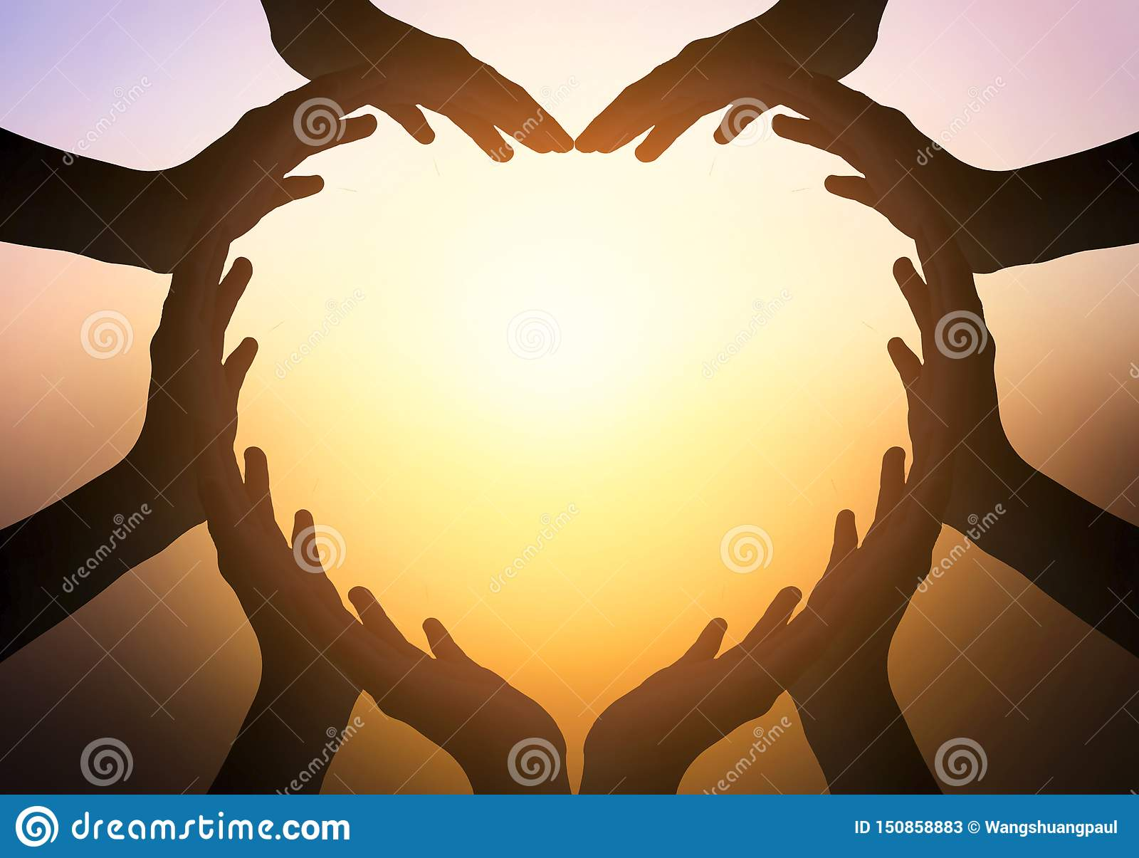 International Day of Friendship concept: hands in shape of heart on blurred background