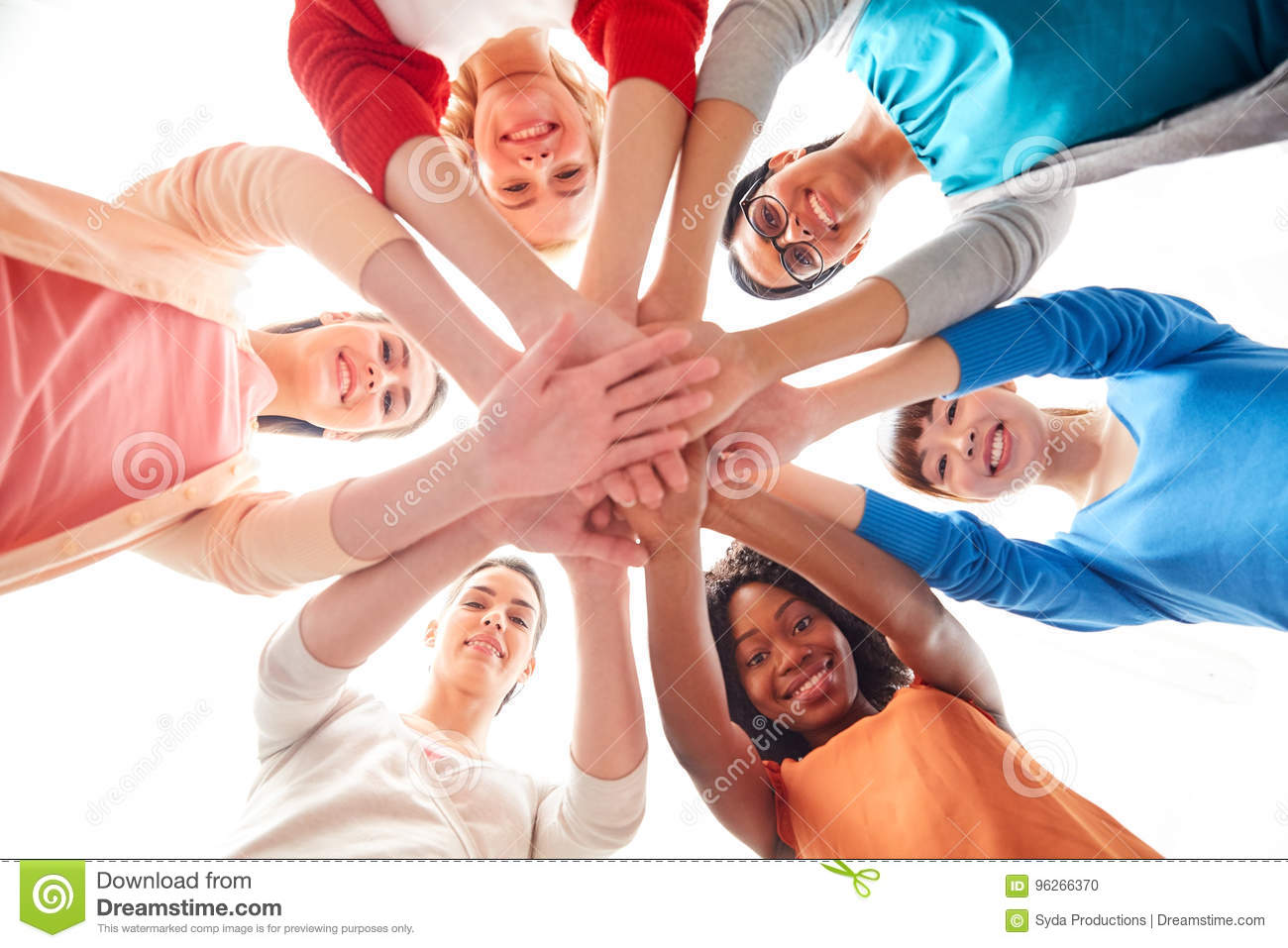 International group of women with hands together