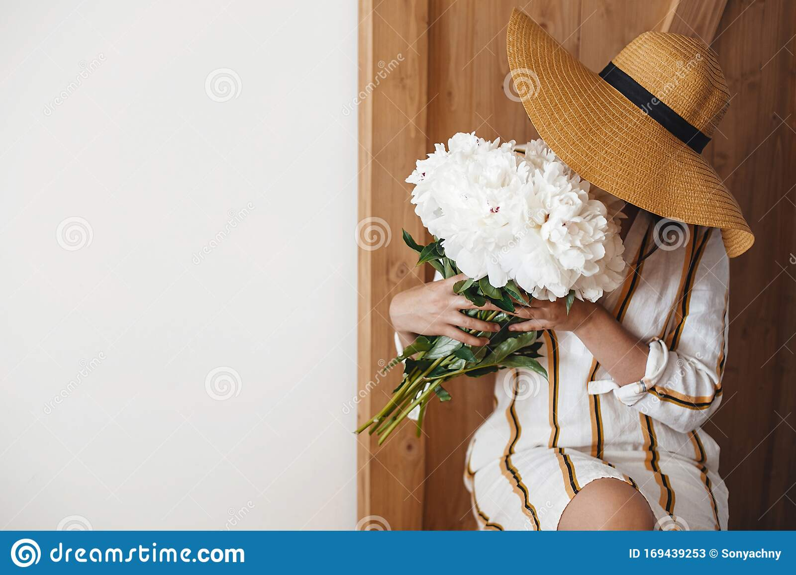 International Womens Days Stylish Boho Woman In Hat Holding White Peony Bouquet On Rustic Wooden Background Space For Text Stock Image Image Of Card Beautiful 169439253