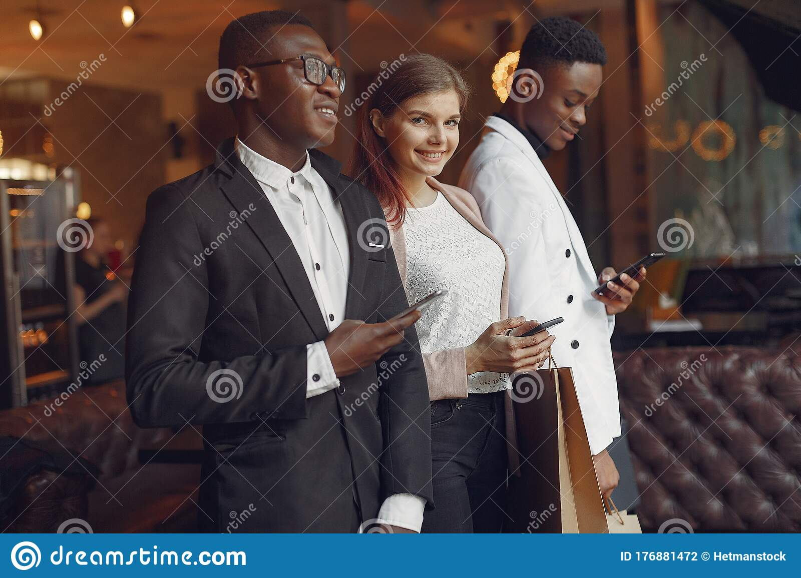 Internationals People Standing In A Cafe With Shopping Bags Stock Photo Image Of Nationality Model 176881472