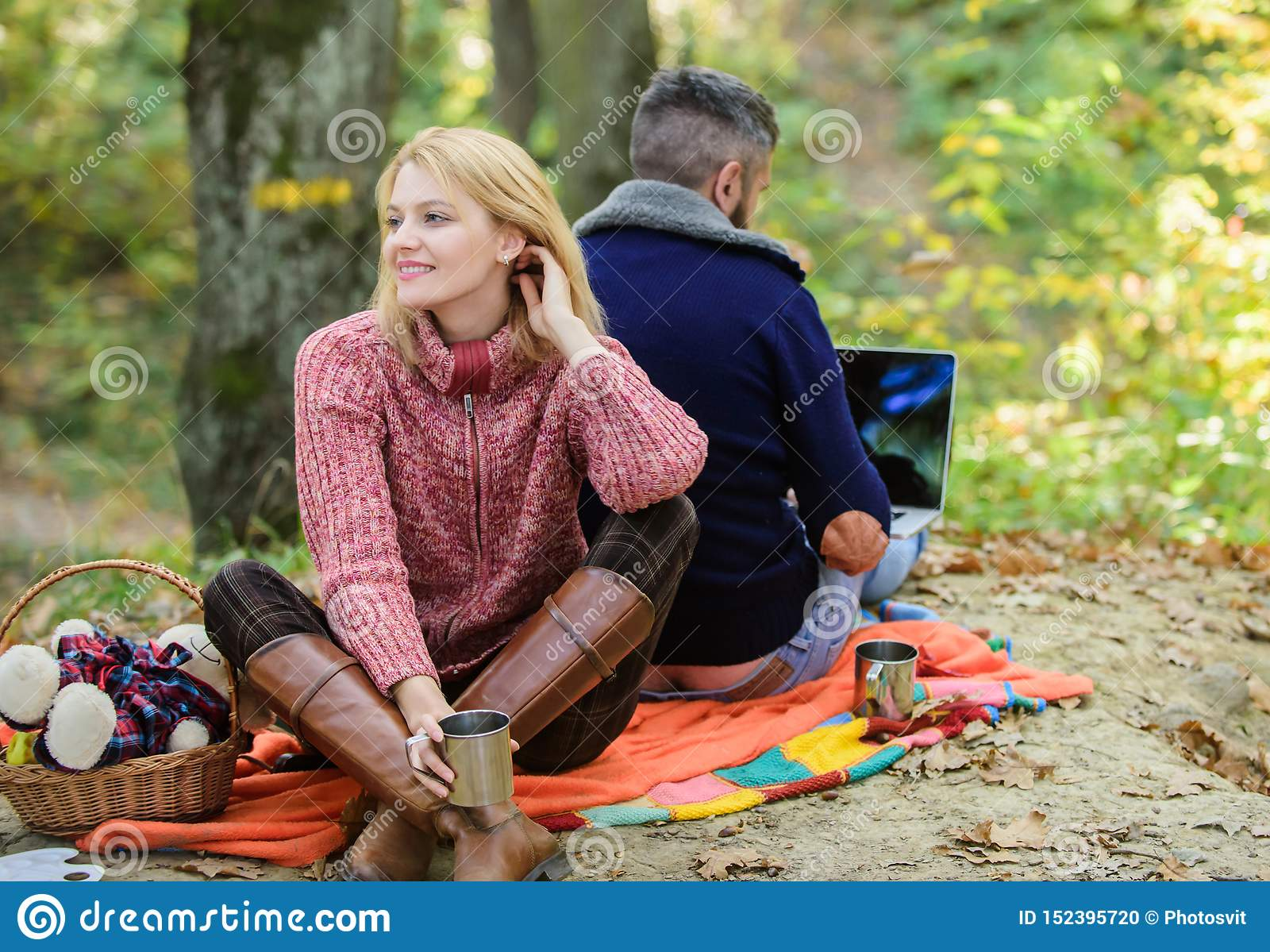Internet addicted husband. Working on fresh air. Surfing internet. Happy loving couple relaxing in park with laptop