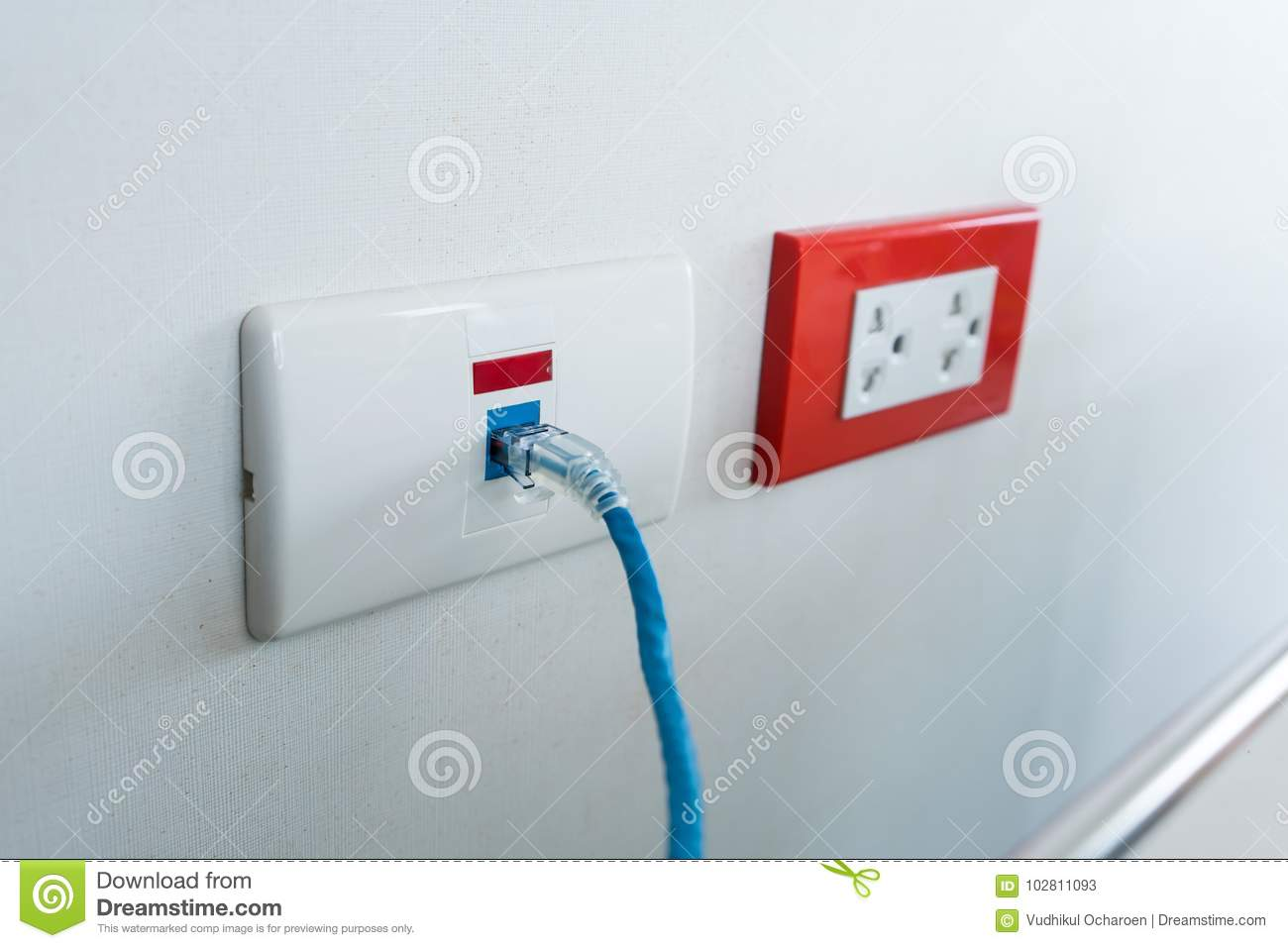 Internet Blue Cable Plug Into The White Network Outlet Stock Image ...
