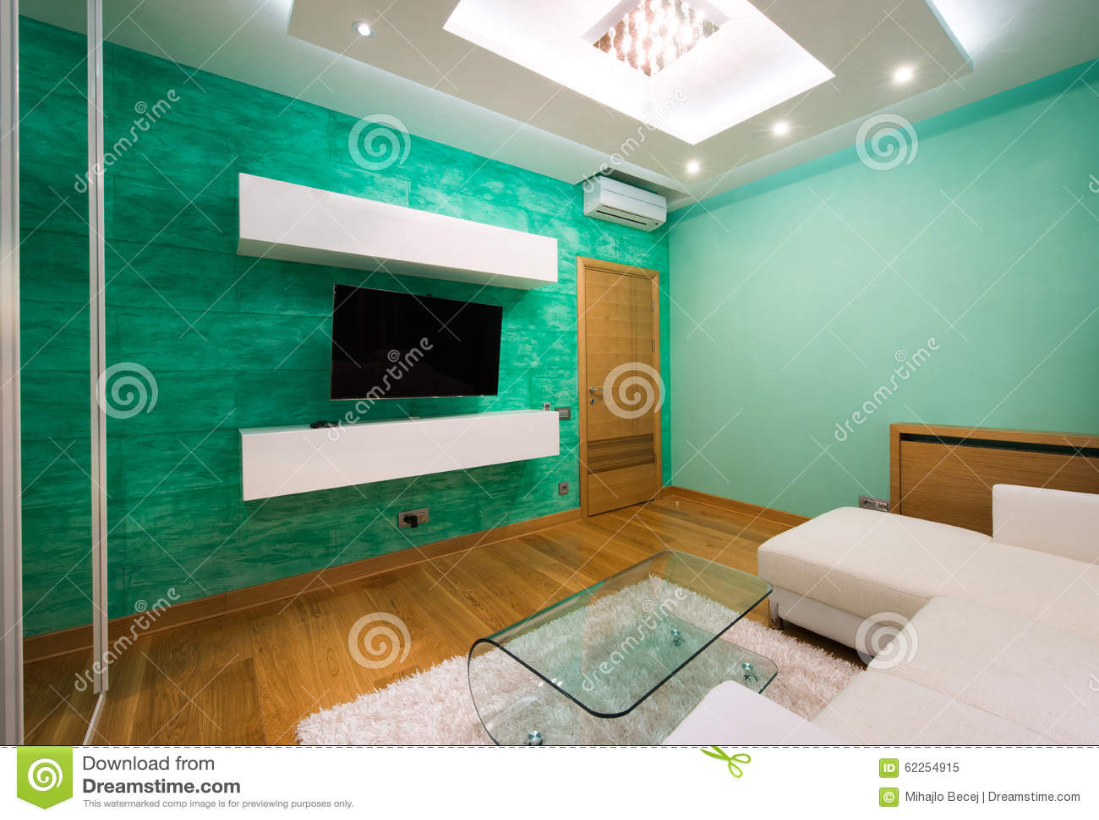 Plafoniere Interno Moderno : Interno di un salone verde moderno con plafoniera lusso