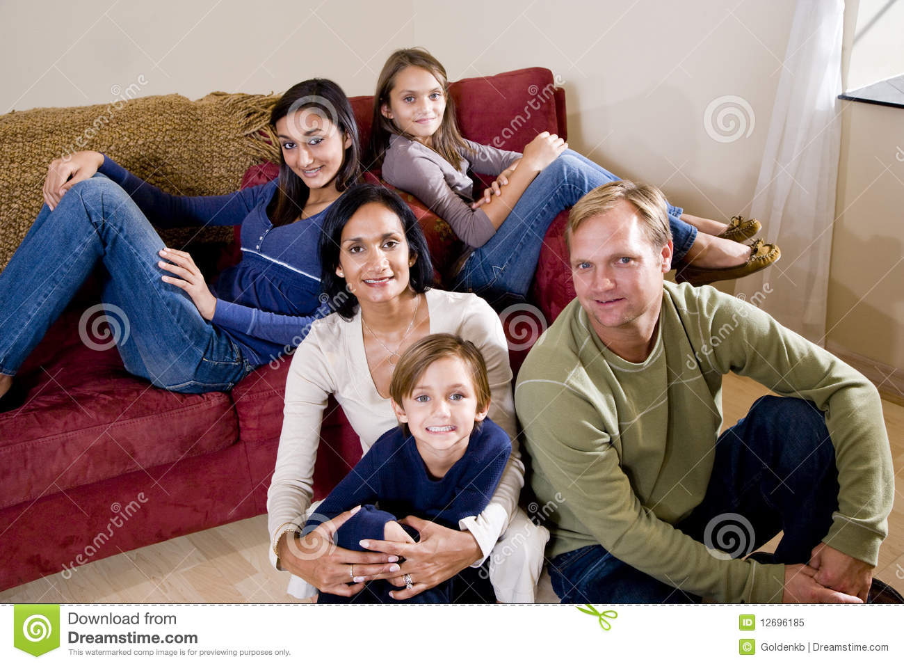 Interracial family of five relaxing at home