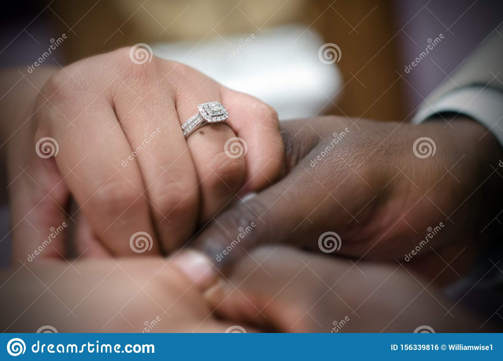 Interracial couple holding hands a the wedding altar