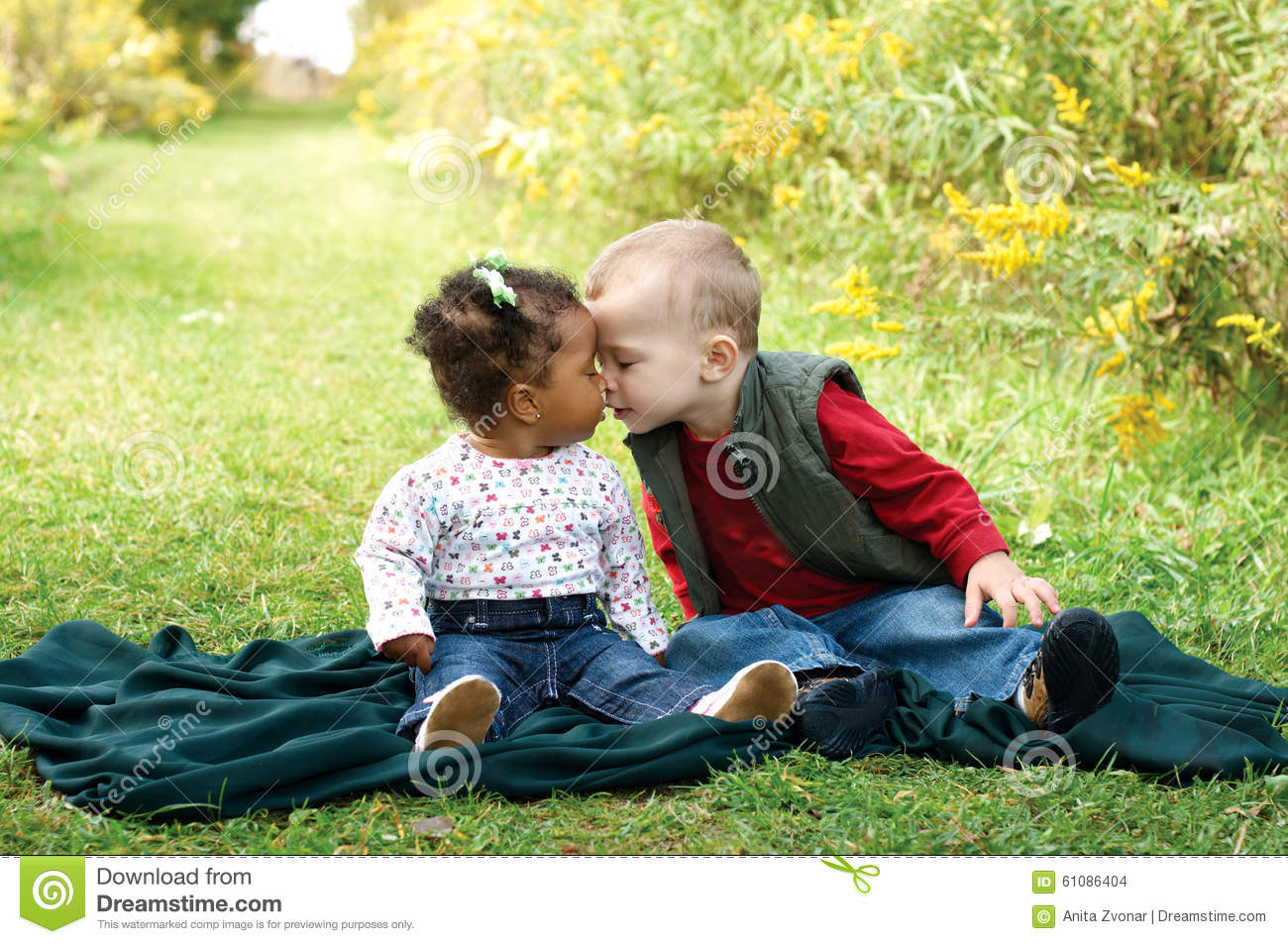 interracial toddlers showing affection fight racism stock