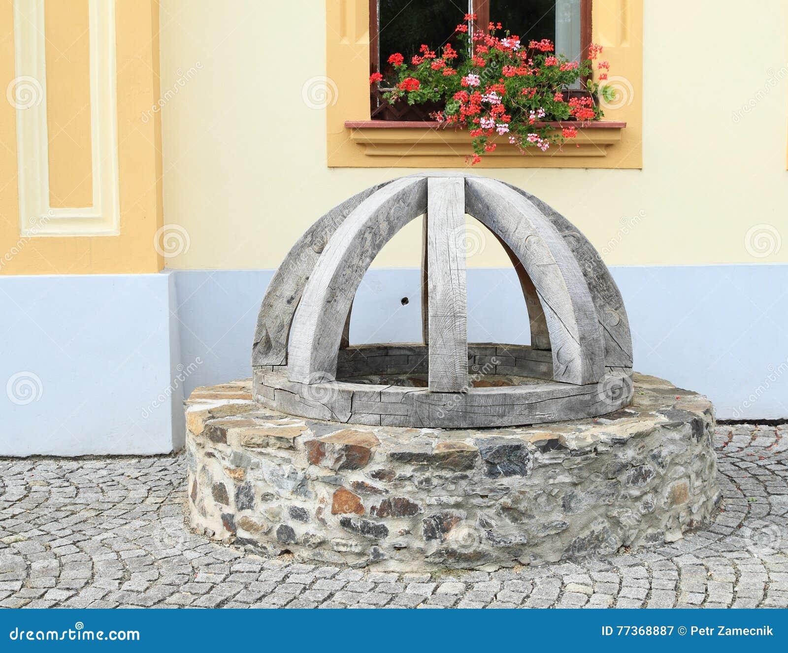 Interrupção de pedra com tampa de madeira