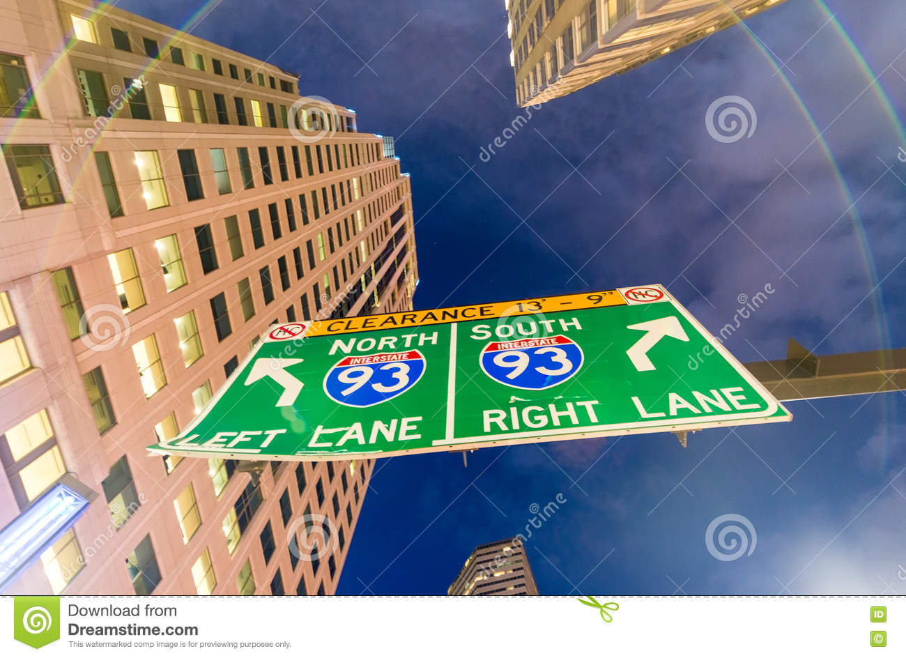 Interstate Road Sign At Night In Downtown Stock Image