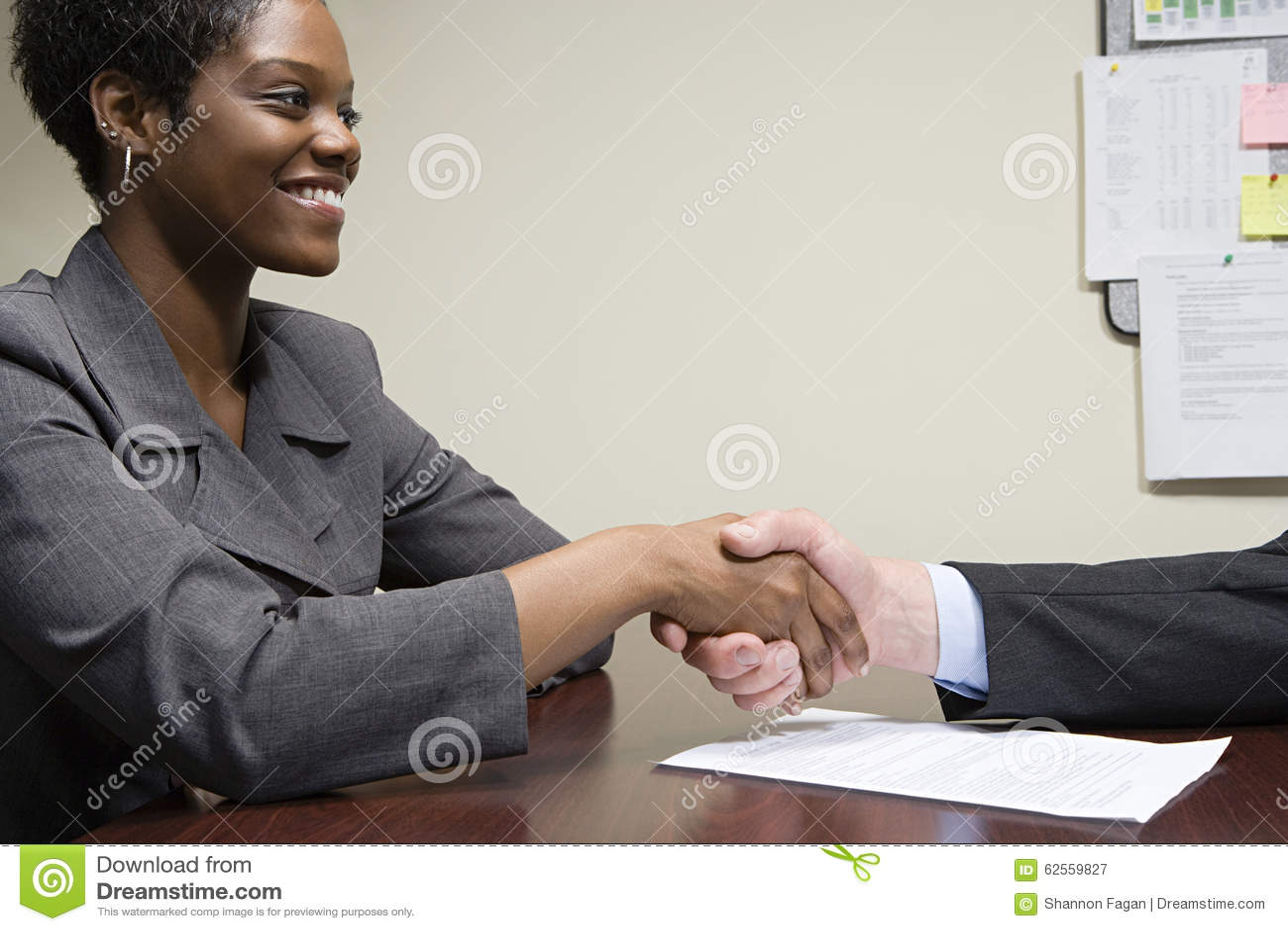 interviewee and interviewer shaking hands stock photo image interviewee and interviewer shaking hands