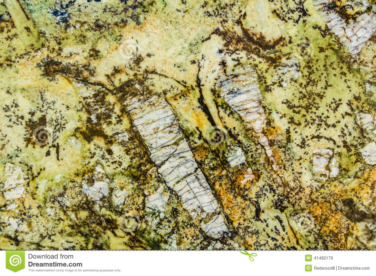 Green And Gold Marble : Intricate pattern of yellow green and gold granite stock