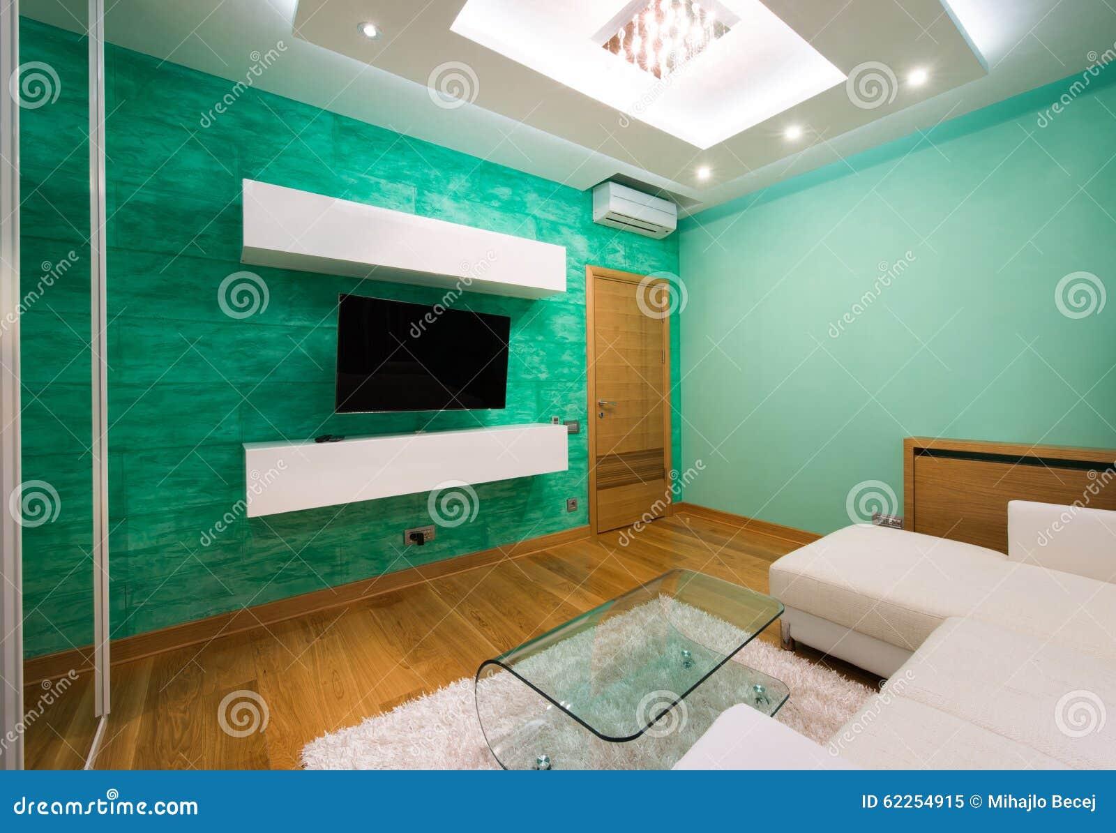 Int rieur d 39 un salon vert moderne avec le plafonnier de luxe photo stock image 62254915 for Un salon de luxe