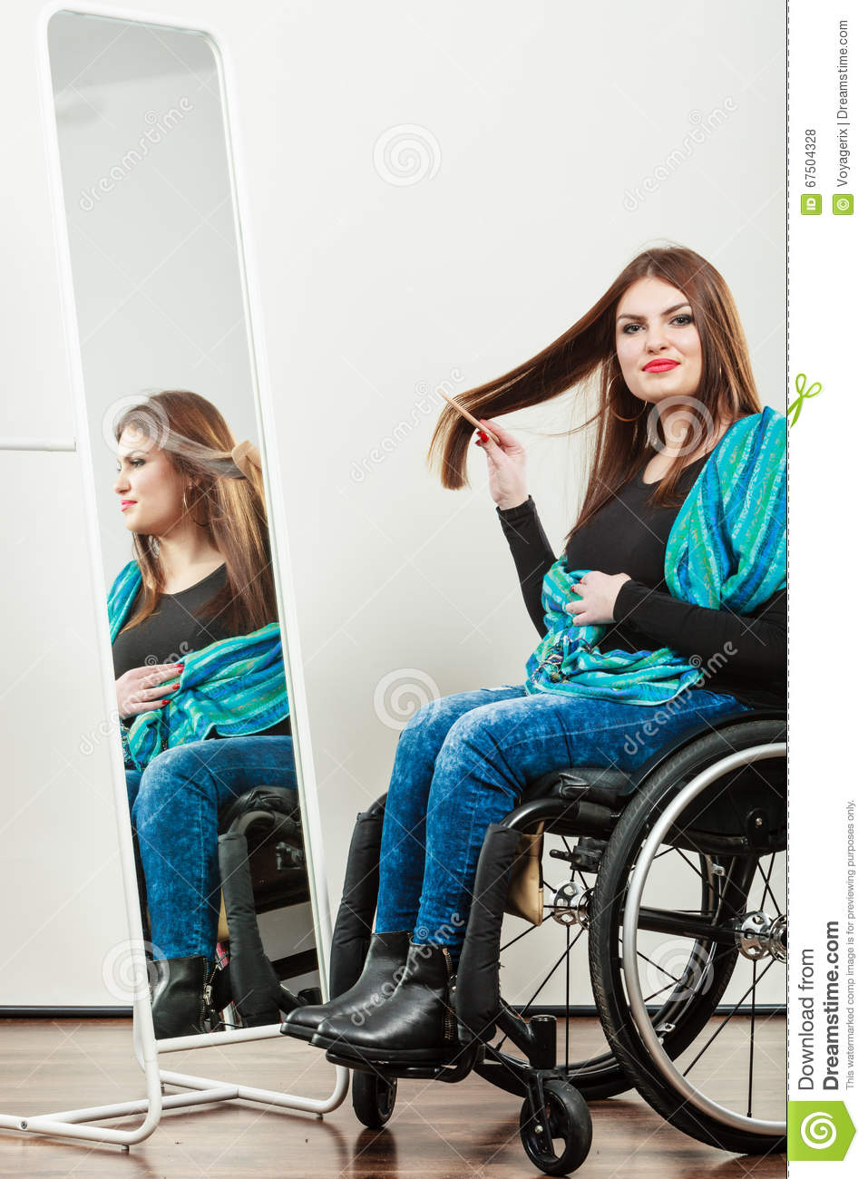 Invalid girl on wheelchair combing hair stock photo for Handicapped wheelchair