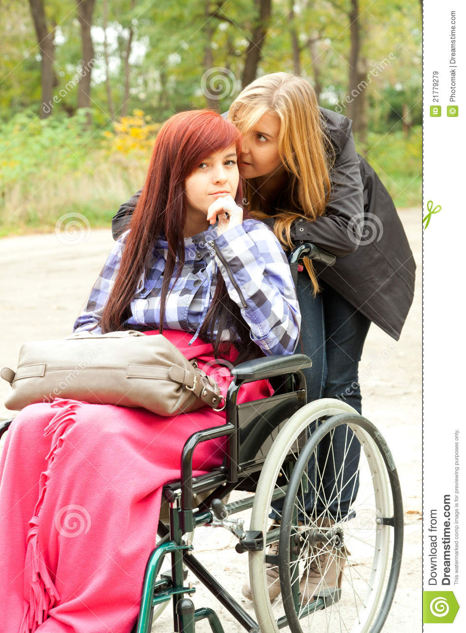 invalid girl on the wheelchair with helper royalty free