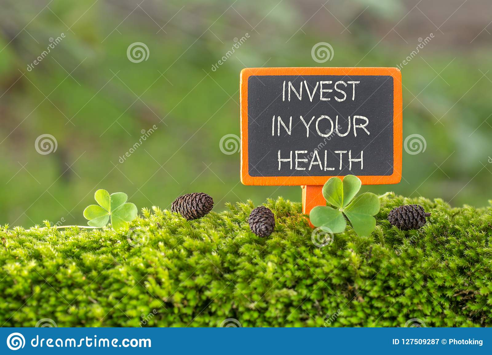 Invest in your health text on small blackboard
