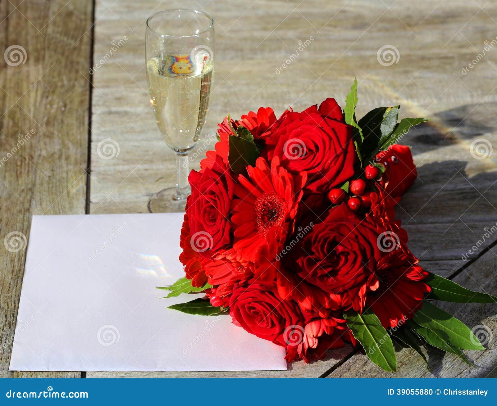 Invitación y flores de la boda