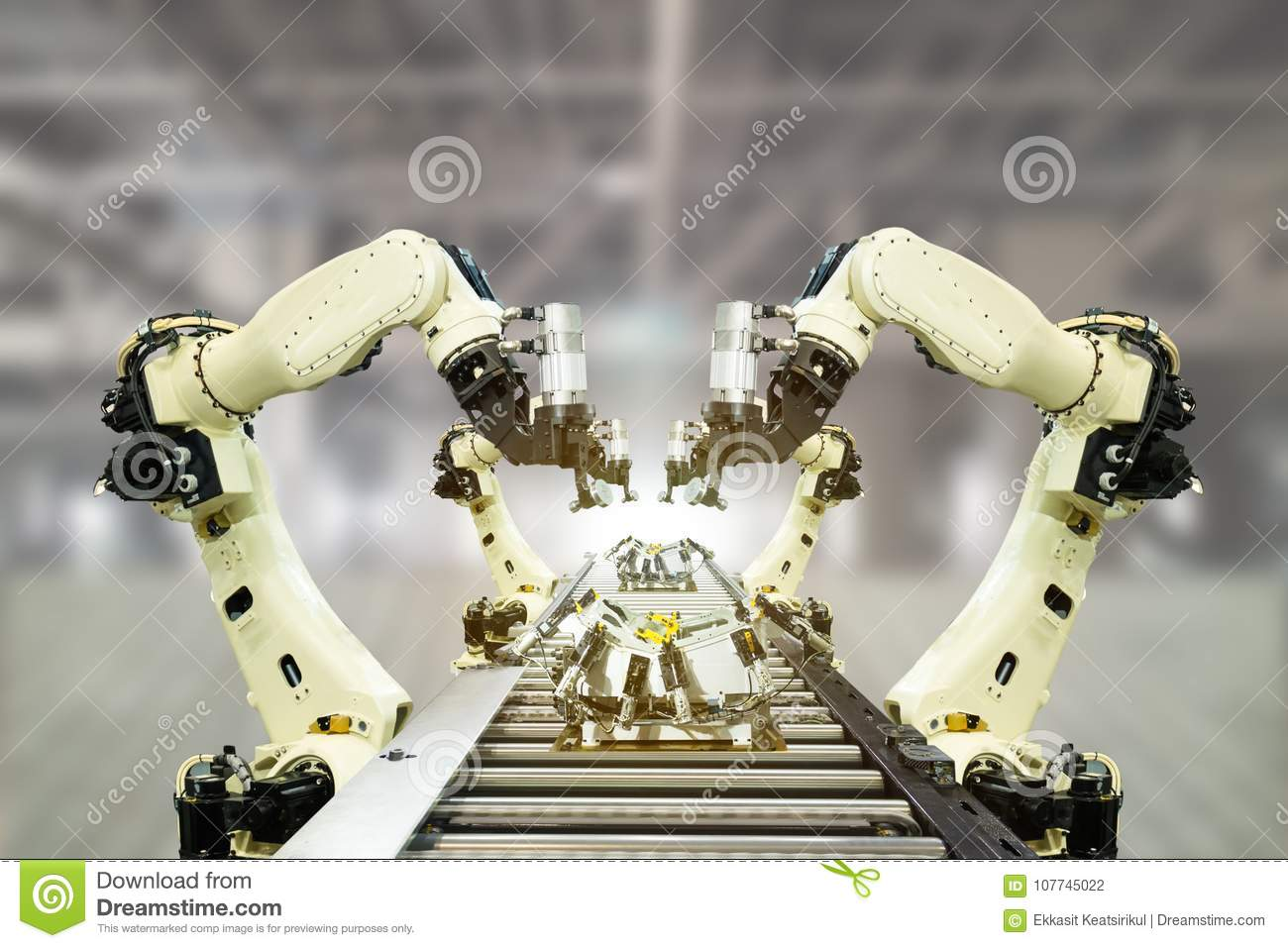 Iot industry 4.0 technology concept.Smart factory using trending automation robotic arms with empty conveyor belt in operation lin