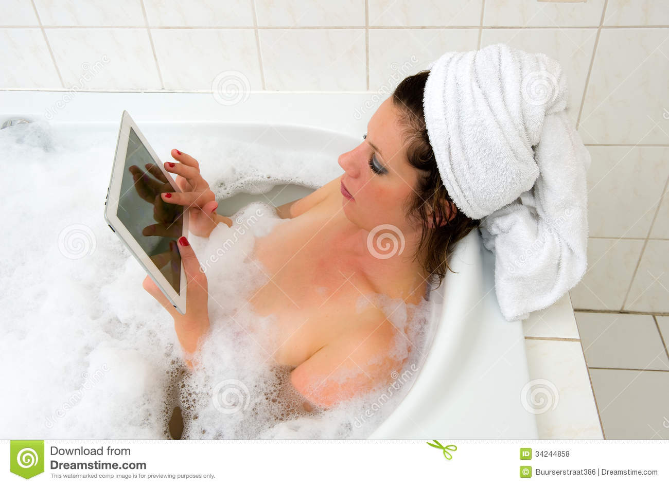 With ipad in bath stock photo image of gaming ipad for Hot bathroom