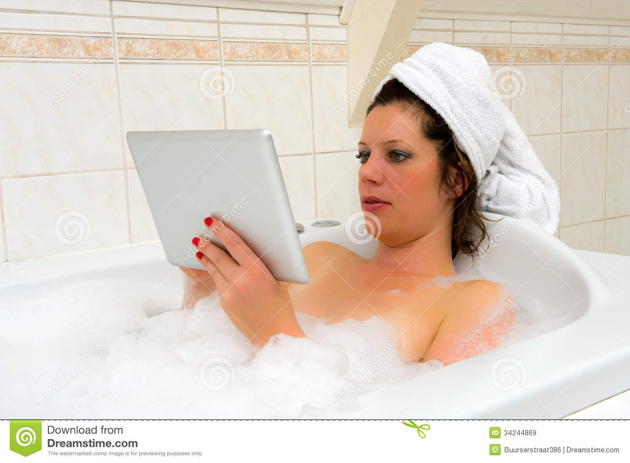 With ipad in bath royalty free stock images image 34244869 for Hot bathroom