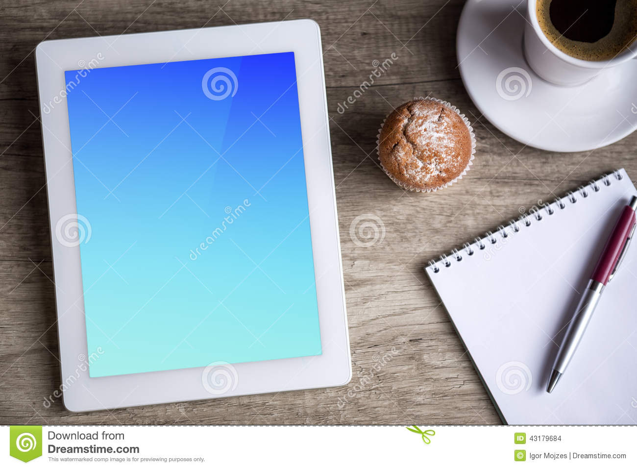 Ipad Tablet With Cup Of Coffee Over Wooden Table Stock