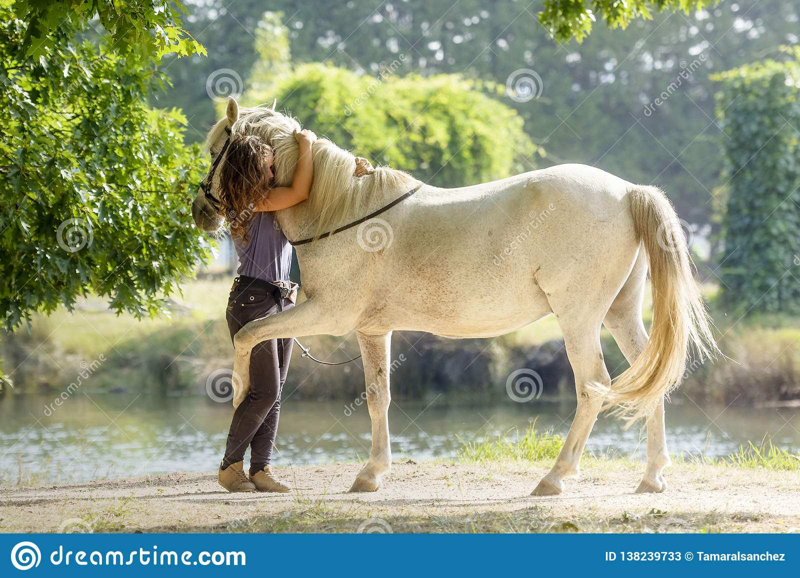 Irene Gefaell with her horse in a demonstration of natural dressage in Pontevedra, Spain, in august of 2018
