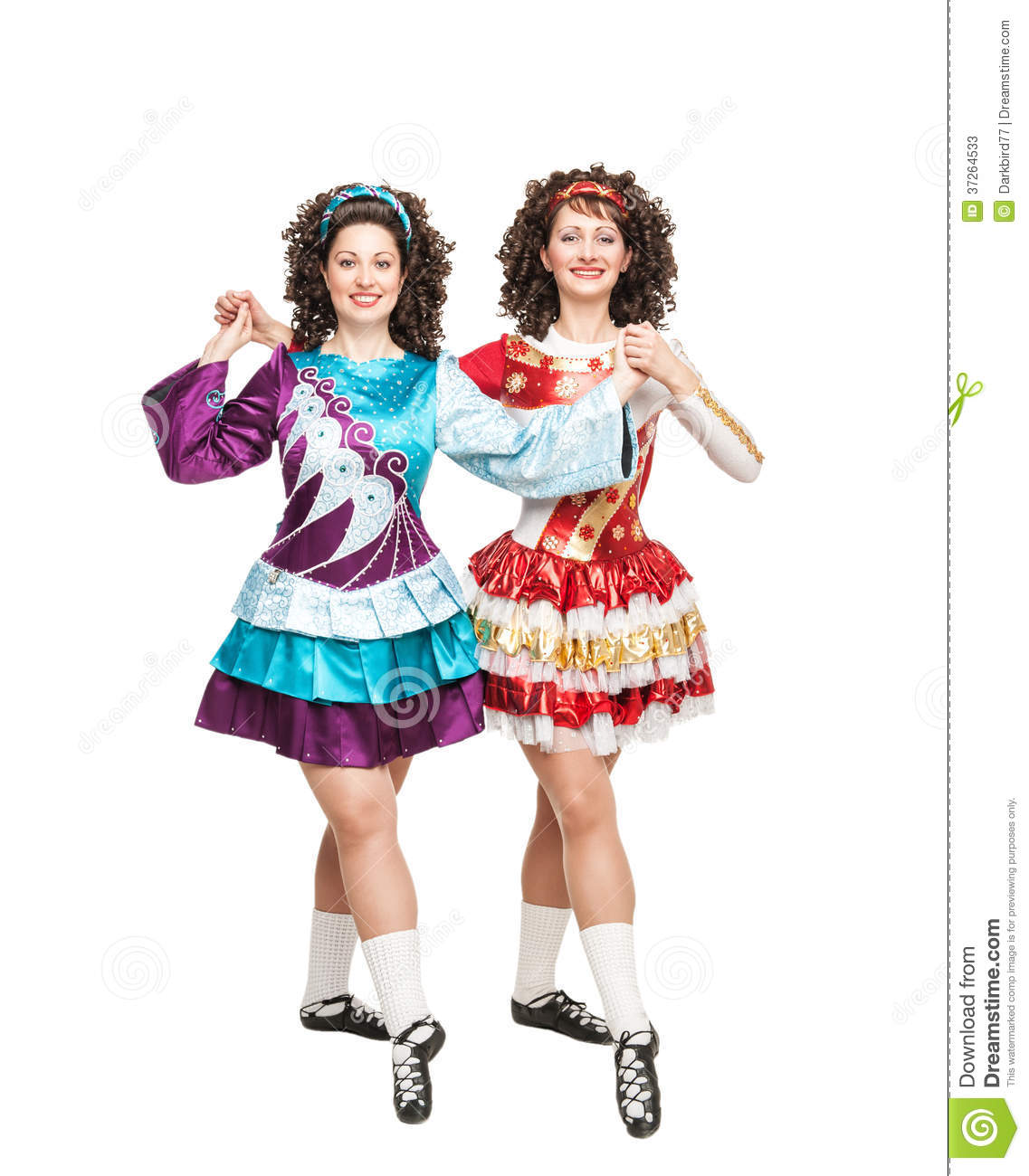 Two young women in Irish dance dresses and wigs posing isolated f48a10de82