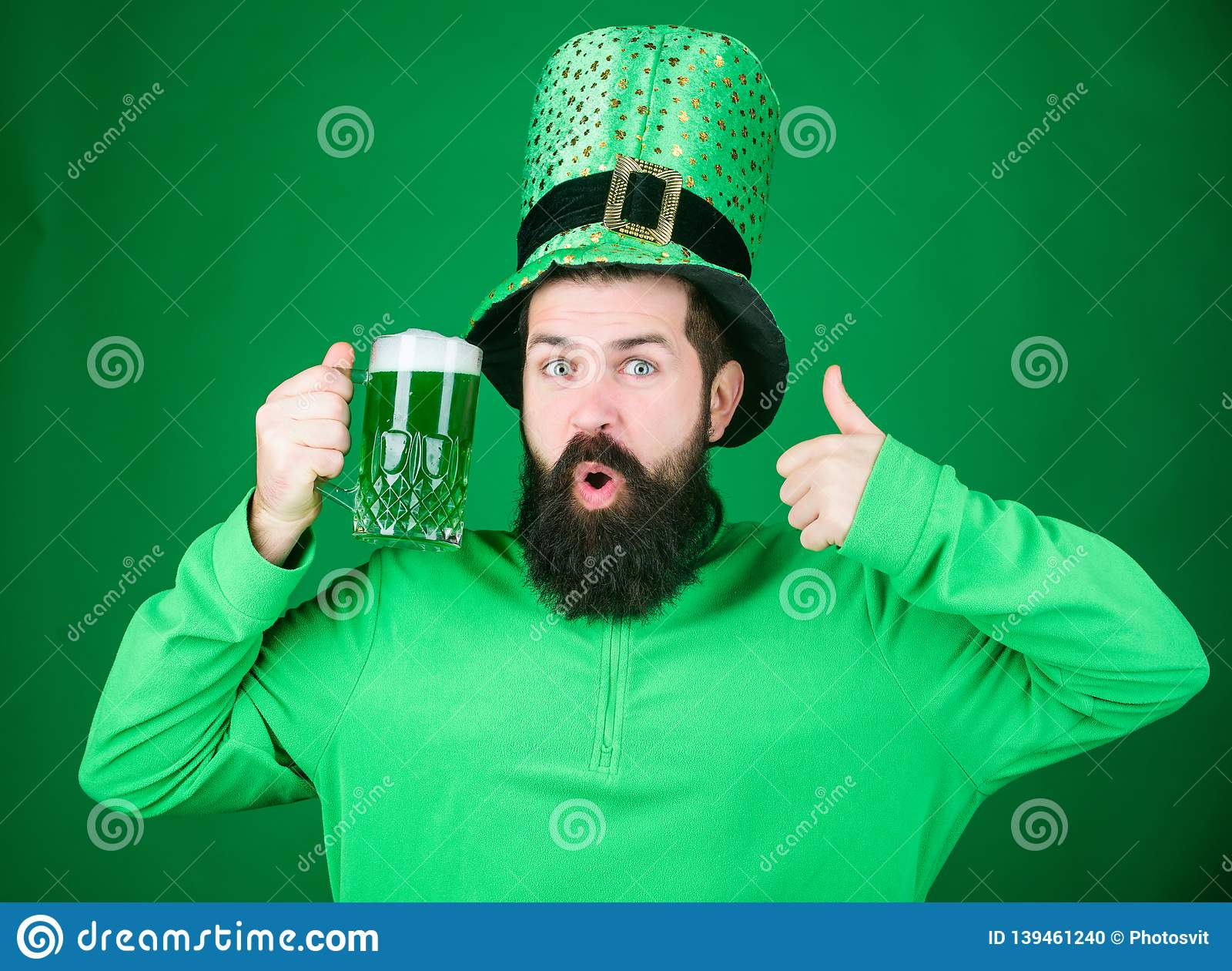 94745b438e Irish Man With Beard Showing Thumbs Up To Green Beer. Hipster In ...