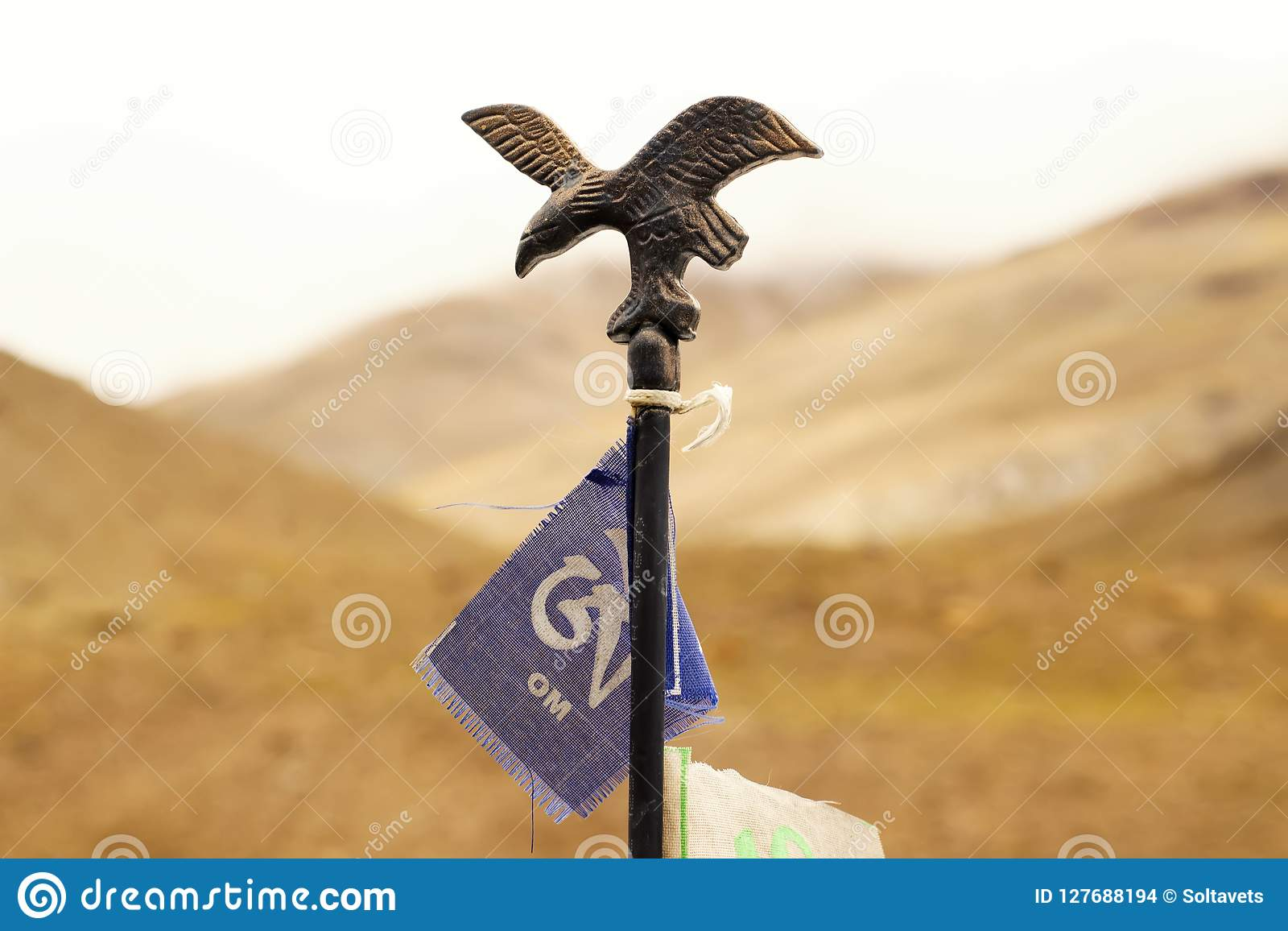 Iron figure of the eagle with the flag of Om