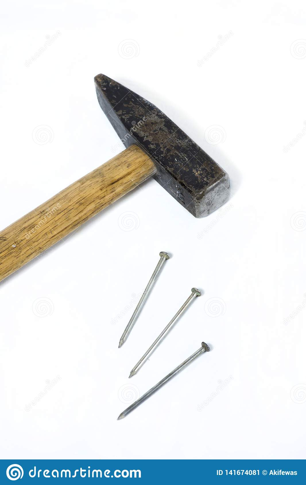 Iron hammer with wooden handle with nails on white background