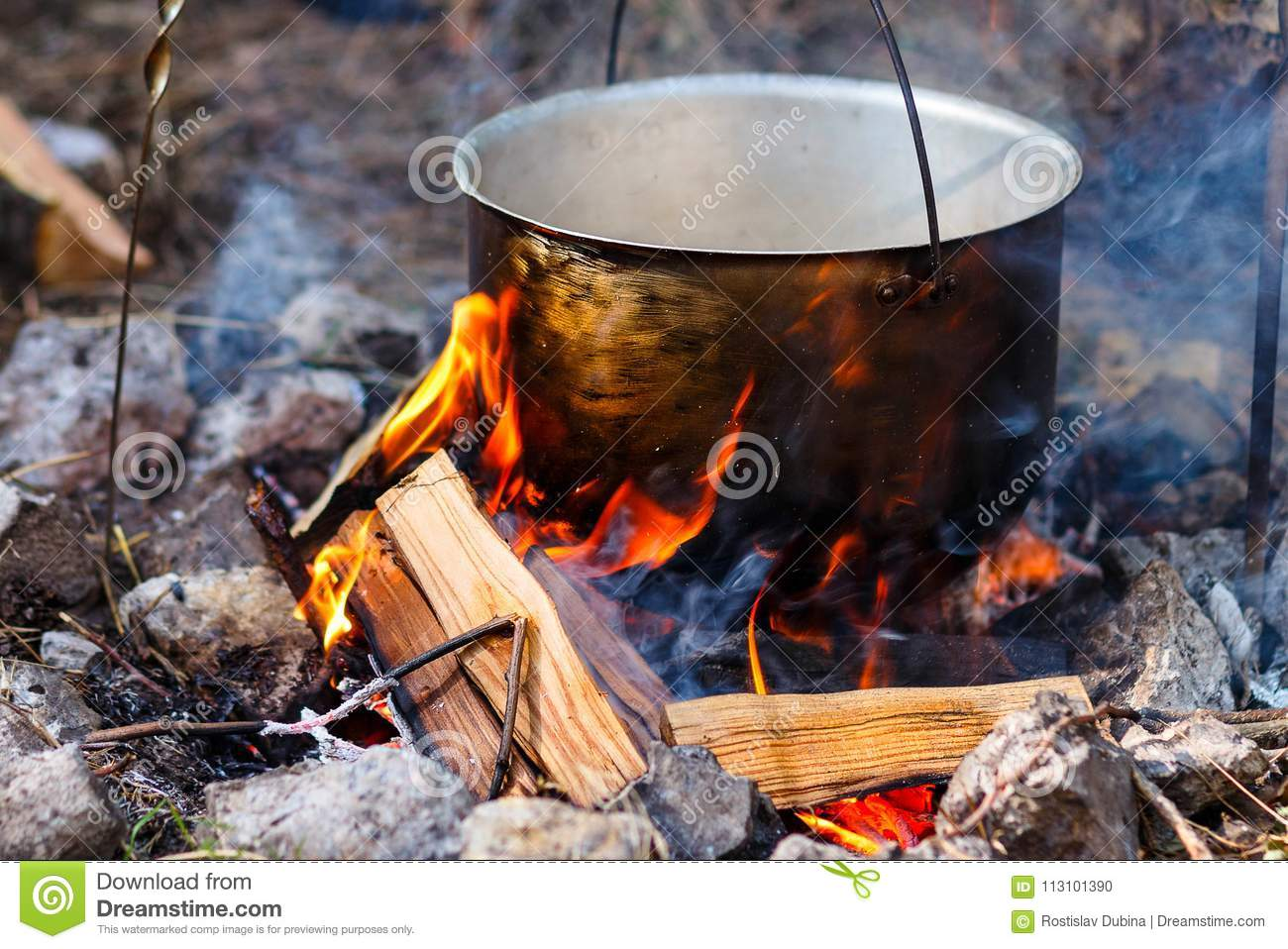 Iron Pot With Food On A Burning Fire  Food In A Metal